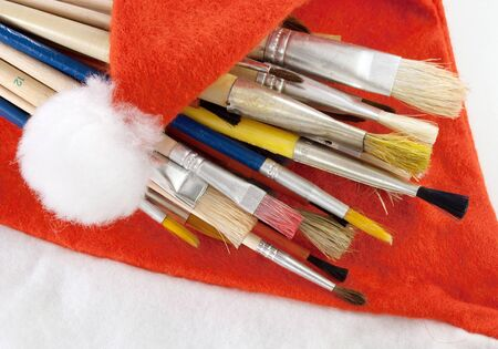 Lots of paintbrushes on Santa's red hat.  photo