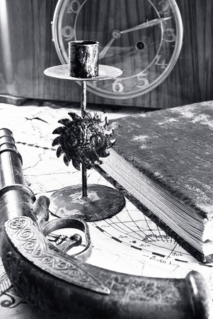 Still life of a navy theme - old candle holder, retro gun and some other items. photo