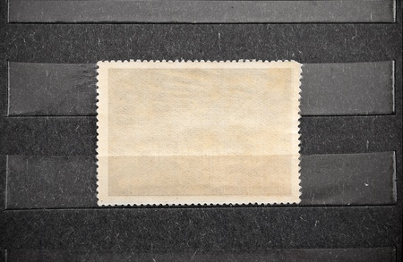 Empty blank of postage stamp in black album. photo