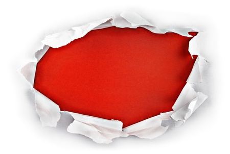 Breakthrough paper hole with red background. photo