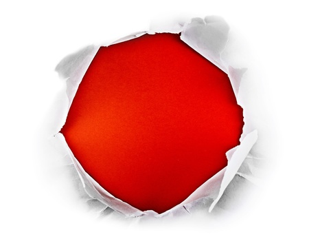 Circle shape breakthrough paper hole with red background. photo
