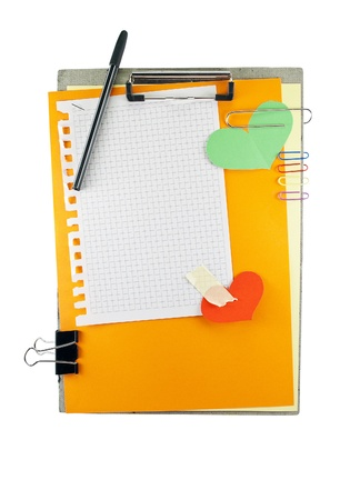 Office clipboard with colorful paper sheets, clips, pen and square pattern sheet. photo