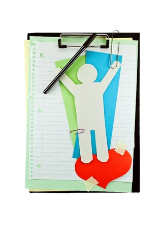Office clipboard with colorful paper sheets, paper heart, clips and paper man. photo
