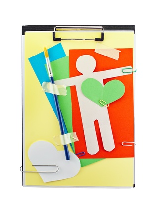 Office clipboard with colorful paper sheets, paper hearts, brush, clips and paper man. photo