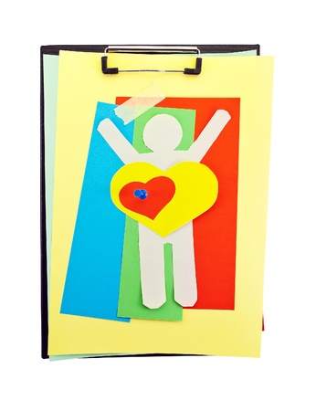 Office clipboard with colorful paper sheets, paper hearts, clips and paper man. photo