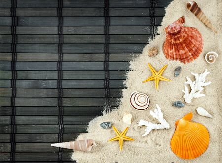 Few marine items on a sand against wooden mat. photo