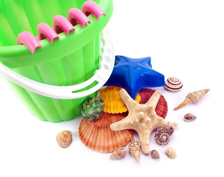 Closeup of summer still life- colorful toys and seashells isolated on white. photo