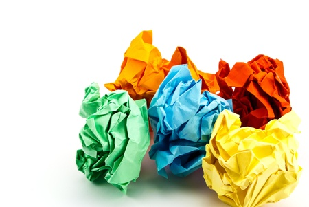Colorful crumpled paper isolated on white. photo