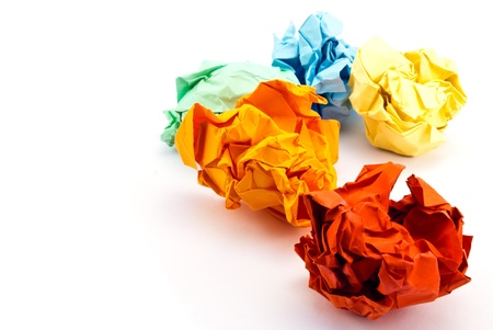 Colorful crumpled paper isolated on white. Foto de archivo