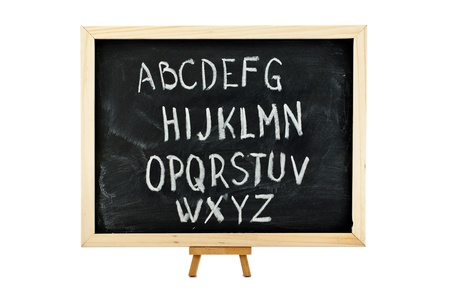 White-chalk inscription of alphabet on a blackboard, isolated on white. photo