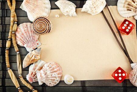 Few seashells on a wooden mat. photo