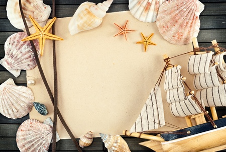 Few seashells on a wooden mat in frame theme. photo