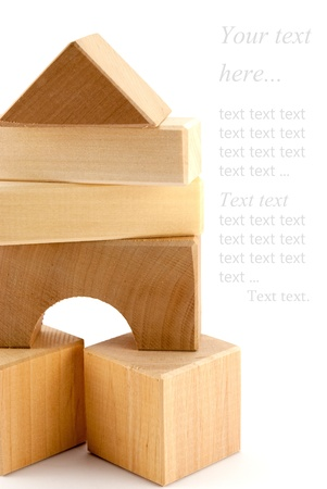 wood block: The composition of toy geometrical shapes over white background.