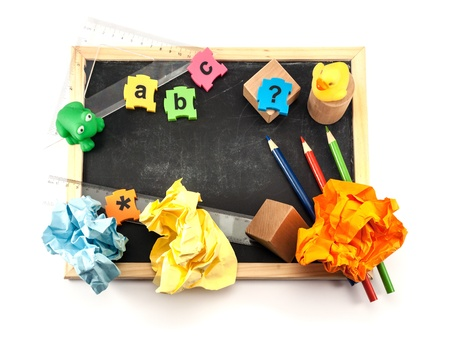 Colorful pre-school items over white background. photo