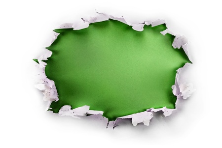 Breakthrough paper hole with green background, isolated on white. photo