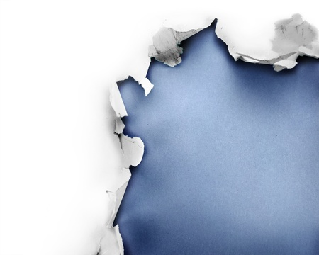 Breakthrough paper hole with blue background, isolated on white. photo
