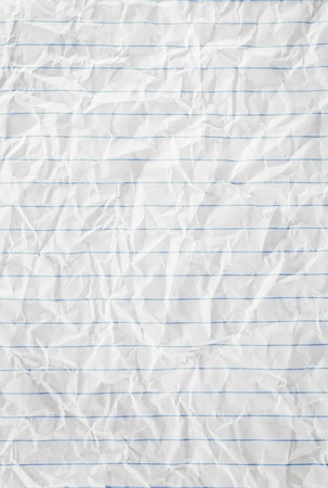 Closeup of crumpled page texture with blue lines. photo