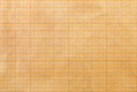 Closeup of orange graph paper texture. photo