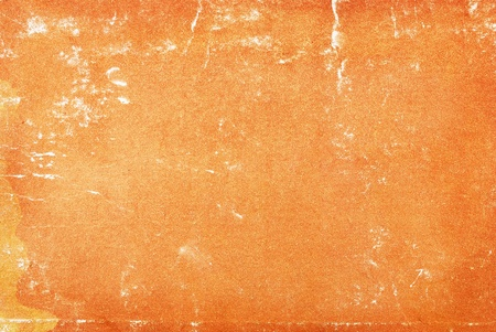 Closeup of grungy orange paper texture. photo