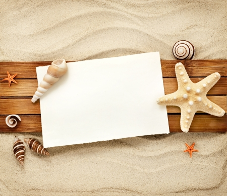 Few marine items on a wooden boards against sandy background. photo