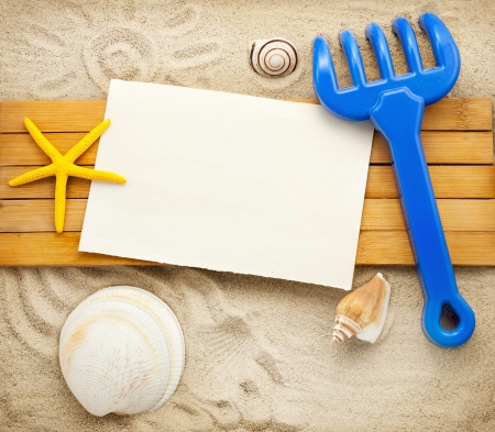 Few marine items on a wooden boards against sandy background. Stock Photo