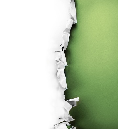Breakthrough paper hole with green background inside, isolated on white. Foto de archivo