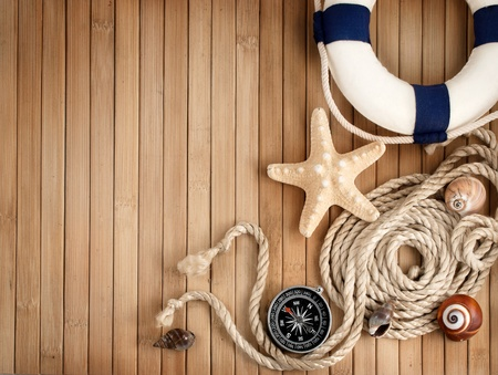 nobody: Few summer marine items on a wooden background  Stock Photo