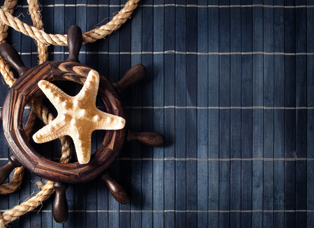 Few nautical items over blue wooden background  photo