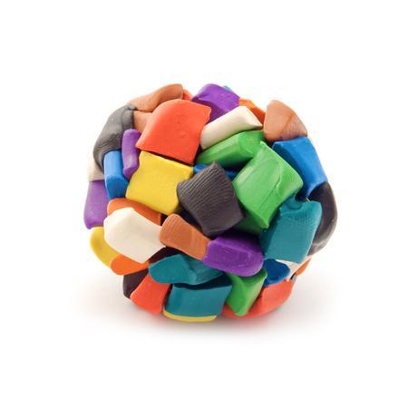 moulded: Bloques coloridos de plastilina moldeados juntos en una esfera sobre fondo blanco. Foto de archivo