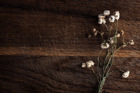 dried flowers: Bouquet of dried flowers on a wooden background.