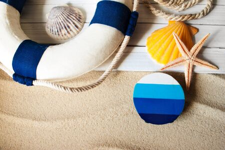 Template background of summer marine items on a sand. Stok Fotoğraf