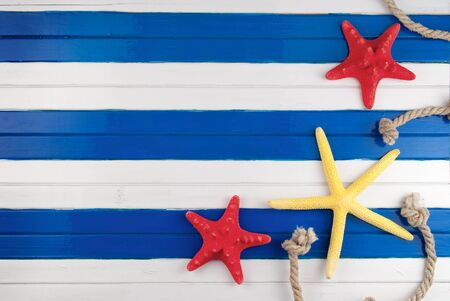 yellow star: Few marine items on a wooden colored background.