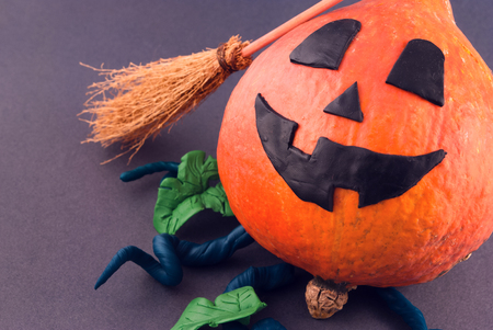 scary face: Halloween pumpkin with plasticine details.