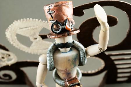 steampunk goggles: Classic wooden dummy in steampunk world.