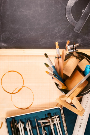 Fragment of engineers workplace and drawing tools. Stock Photo