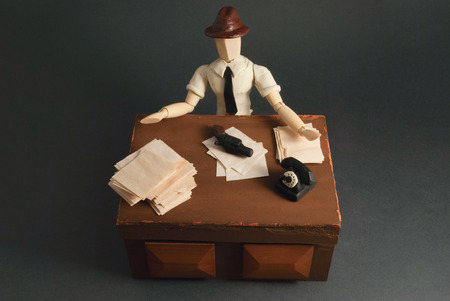 noire: Classic wooden dummy in noir detective scene. Stock Photo