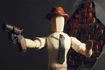 dummy: Classic wooden dummy in noir detective scene. Stock Photo