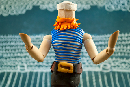 Wooden dummy as a sailor man with red beard. Stock Photo