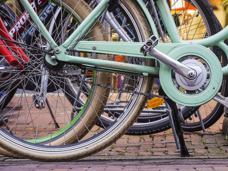 spoked: Aurich, Germany - December 28, 2015: Low angle view of a row of standing bicycles in Aurich  Ostfriesland