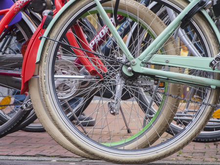 angled view: Aurich, Germany - December 28, 2015: shallow angled view of in a row of bicycles in Aurich  East Frisia Editorial