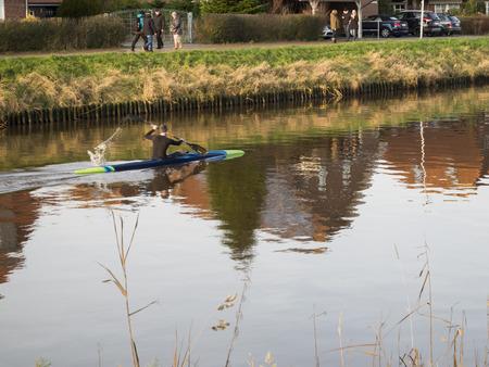 paddler: Carolinensiel, Germany - December 30, 2015: single paddler on the Harle near the town of Carolinensiel