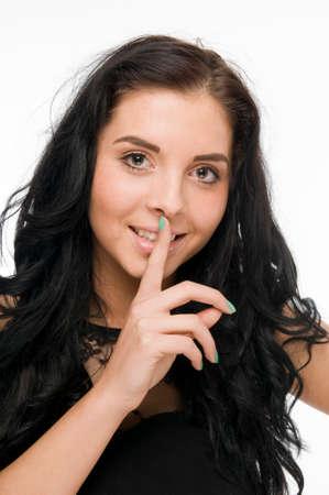 exempted female: Julia finger on lips Stock Photo