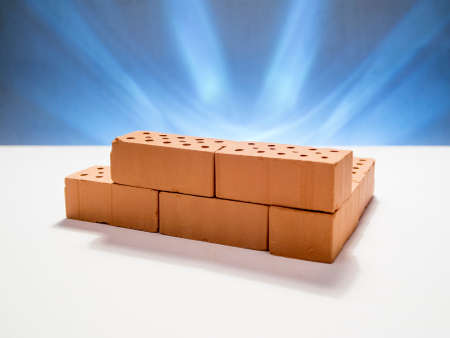 mini bricks on white background blue illuminated