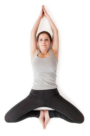 Yoga woman gray_supta baddha konasana_top view Stock Photo