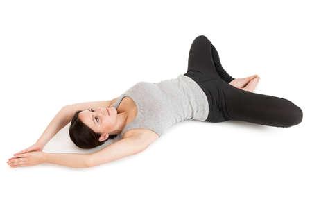 Yoga woman gray_supta baddha konasana_left Stock Photo