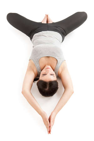 Yoga woman gray_supta baddha konasana_upside down