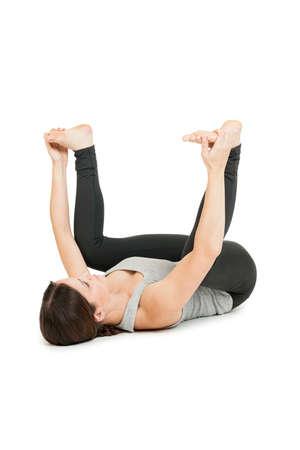 Yoga woman gray_anada balasana_spread wide Stock Photo