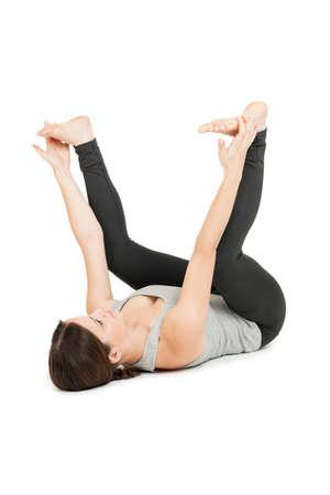 Yoga woman gray_anada balasana_spread middle Stock Photo