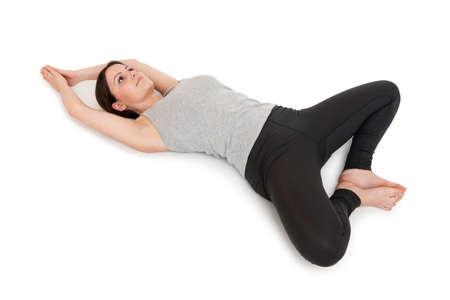 Yoga woman gray_supta baddha konasana_right Stock Photo