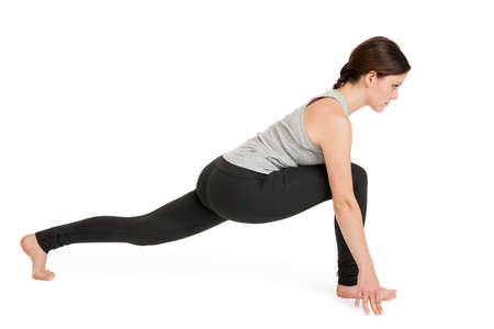 Yoga woman gray position_ashva sanchalanasana